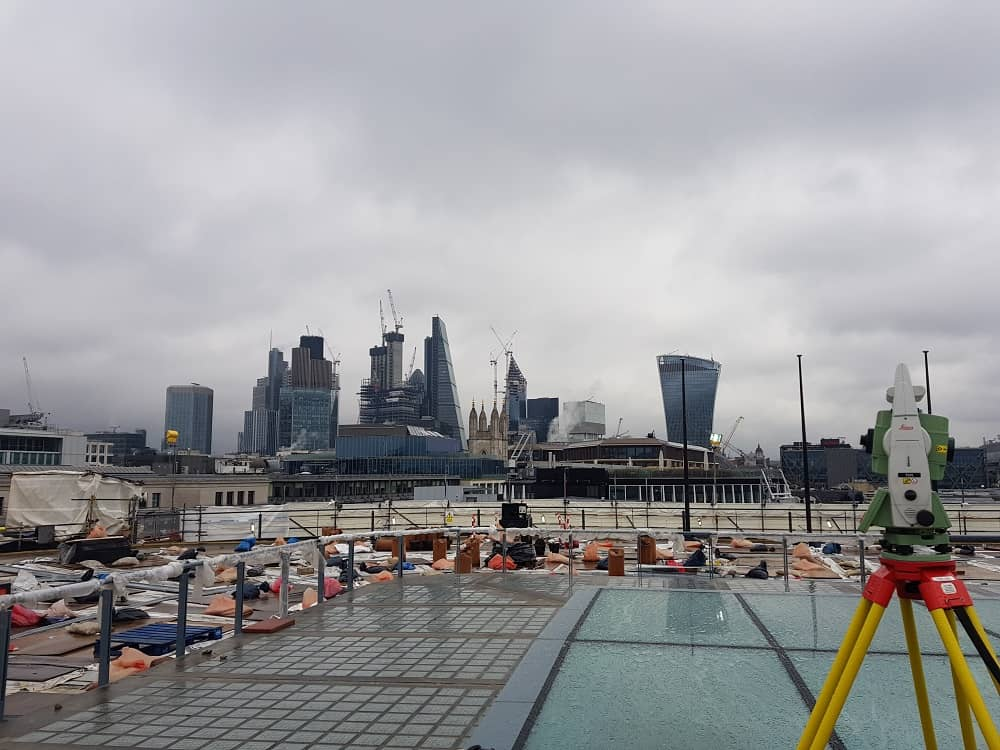 total station on roof looking towards City of London