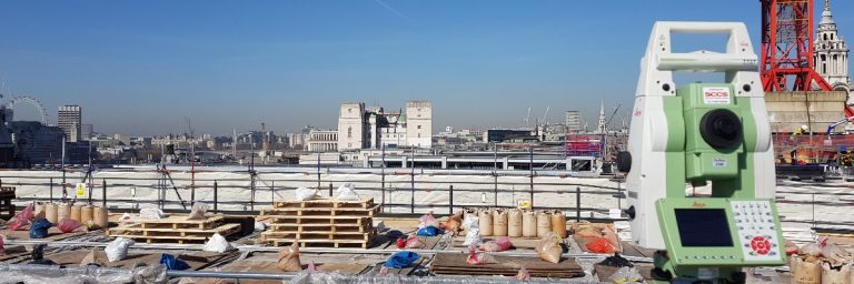 Leica total station on rooftop building site