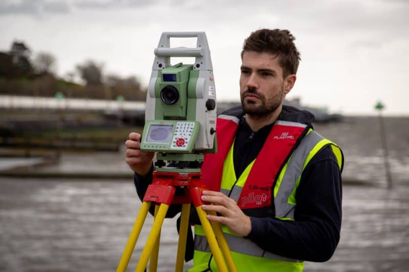 man conducting topographical land survey in Essex