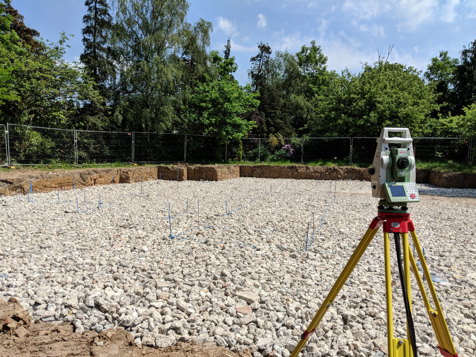 total station conducting a setting out survey at Mill Way