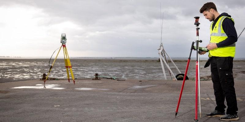 land surveyor working on a beach