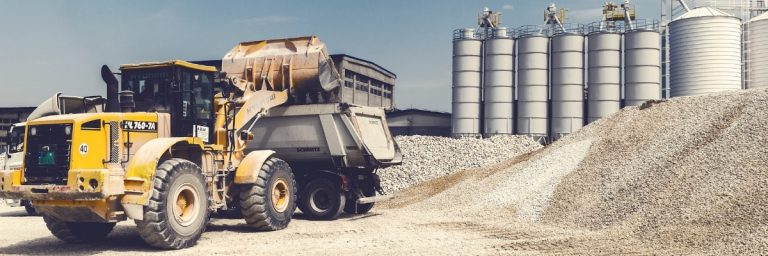 dumper truck loading a lorry with gravel
