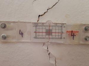 Crack gauge installed on wall